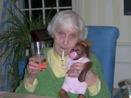 Grandma has a monkey, grandma has campari. Grandma drives fast when she's driving her Ferrari
