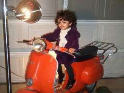 purple rain kid on scooter looks like prince